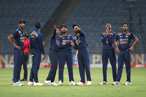 Team India watch Screen for Third Umpire decision for run out appeal against Ben Stocks in 2nd ODI at Pune